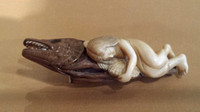 Netsuke: Diving girl sleeping on dried bonito